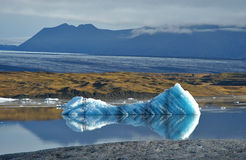 Mountains and Iceberg. A landscape image of the mountains behind an iceberg stock photography