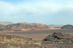 Mountains in the Immense desert in Jordan. Mountains in the desert called Wadi Rum in Jordan in the Middle East Royalty Free Stock Photo