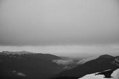 Mountains immersed in the clouds Stock Photos