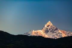 Mountains inspirational landscape, Himalayas. Mountain inspirational beautiful sunset landscape in Himalaya Mountains. Himalayas peak Machhapuchhare 6993m ASL royalty free stock photo