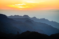 Mountains inspirational sunset landscape, islands and ocean Royalty Free Stock Image