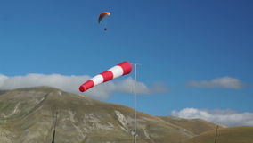 In mountains of Italy wind sleeve and paragliding stock video footage