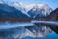 The mountains of Japan winter moved on the surface of the lake Royalty Free Stock Image