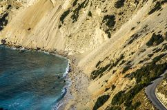 Mountains of Kefalonia plummeting over its beaches Royalty Free Stock Image