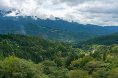 Mountains of Kiso Valley in Gifu prefecture, Japan. Forest mountains and hills with mountain road on overcast day. Kiso Valley in Gifu prefecture, Japan Stock Photo