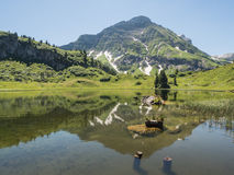 Mountains and the Koerbersee lake around the village Schroecken Royalty Free Stock Image