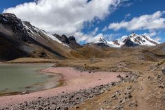 Mountains with a lagoon as seen from the Ausangate Trek, Andes Mountains, Peru royalty free stock images