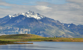 Mountains and lake. Snowed mountains and lake at patagonia, Argentina Stock Image