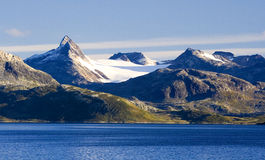Mountains and lake. Snow-covered mountains with lake Stock Photography