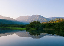 Mountains and Lake. Still morning landscape with mountains and lake in hawaii Stock Images