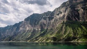Mountains and lake against a cloudy sky. Gunib district of Dagestan stock photos