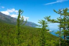 Mountains on Lake Baikal. Blue sky, sun day royalty free stock photo