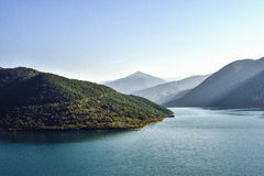 Mountains lake. Beautiful and peaceful blue mountains lake scene Royalty Free Stock Images