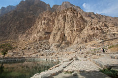 Mountains and lake in beautiful persian valley with historical rocky reliefs Stock Photos