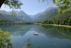 Mountains, lake and boat. View of lake Genos Loudenville at the Hautes-Pyrenees in France Royalty Free Stock Image