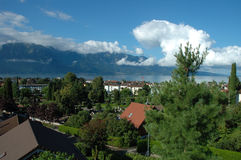 Mountains, lake and buildings in La Tour-de-Peilz in Switzerland. Mountains, Geneve lake and buildings in La Tour-de-Peilz in Switzerland Stock Photo