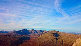 Mountains of the Lake District. The sun shines down on the colourful mountains of the Lake District Royalty Free Stock Photos