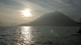 Mountains and lake in the evening light of the setting sun. stock video footage