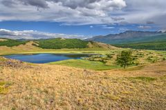 Mountains lake forest tree cloudy Royalty Free Stock Image