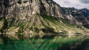 Mountains and lake. Gunib district of Dagestan. Mountains and transparent lake against a cloudy sky. Gunib district of Dagestan stock images