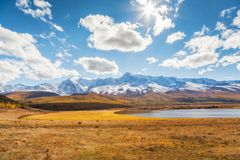 Mountains and a Lake. Landscape panorama. Stock Photo