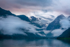 Mountains and lake in mist in the morning, Norway Stock Photo