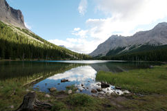 Mountains lake with morning reflection Royalty Free Stock Images