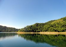 Mountains and Lake. Peaceful landscape from Hanabanilla Lake between  the  Escambray mountains at the cemter of Cuba Royalty Free Stock Photos