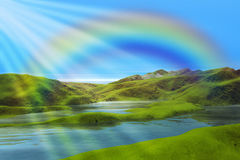 Mountains lake and rainbow. Mountains landscape with blue sky, lake, sunlight and colorful rainbow stock photo
