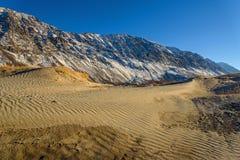 Mountains lake sand snow autumn Stock Photo
