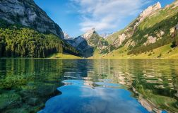 Mountains and lake in the Switzerland. Reflection on the water surface. Natural landscape in the Switzerland at the summer time. Lake and wave stock photos