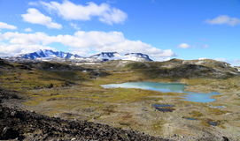 Mountains and lakes. Ice and lakes at top of the mountain at jotunheimen national park in Norway royalty free stock image
