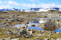 Mountains and lakes. Ice and lakes at top of the mountain at jotunheimen national park in Norway stock image