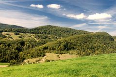 Mountains landscape. Beautiful blue sky and green grass with and mountains royalty free stock image