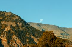 Mountains landscape full moon. Mountains landscape and blue sky with full moon nature background royalty free stock photography
