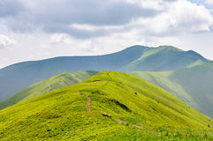 Free Mountains Landscape. Green Slopes And A Path That Runs Along The Top Of The Mountain. Nature Backgrounds Stock Photos - 95690363