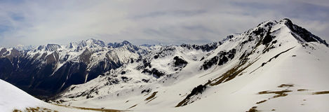 Mountains landscape. From pass Kyzyl-Aush. Mountains with snow. Caucasus, Russian Federation. From pass Kyzyl-Aush Royalty Free Stock Photography