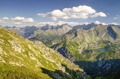 Mountains Landscape in Polish Tatra. Panorama of the Polish Five Lakes Valley and the Slovakia Tatra Mountains from ridge stock photography