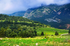Mountains landscape in Pyrenees under cloudy sky Stock Photos