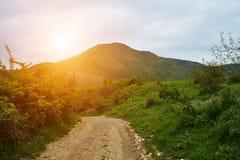 Mountains landscape, road, sunrise Stock Photo