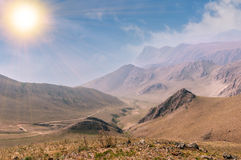 Mountains landscape. With road under sun Stock Photography
