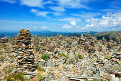Mountains landscape with stone pile Stock Images