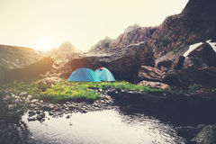 Mountains Landscape and tents camping Stock Photo