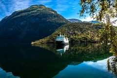 Mountain Landscape with View of A Cruiseship and Mountains from Geiranger Fjord in Summer royalty free stock images
