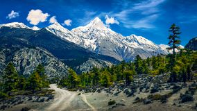Mountains landscape view with snowed peaks and curvy road, Himalayas, Nepal stock image