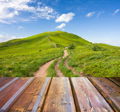 Mountains landscape with wooden planks Stock Photography