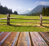 Mountains landscape with wooden planks Stock Images