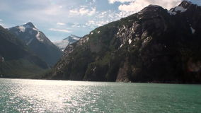 Mountains landscapes on background of calm water of Pacific Ocean in Alaska. stock video footage