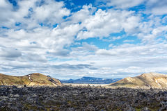 Mountains and lava fields in Landmannalaugar valley in Iceland. View of mountains and lava fields in Landmannalaugar valley in Iceland Stock Images