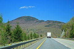 Mountains On The Left On Quebec Highway 10. Traveling east on highway 10 going toward Sherbrooke, Quebec from Montreal and Granby. The mountains of the Eastern royalty free stock images